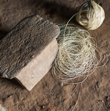 A ball of buriti fibre yarn for making a hammock, with a carved Waura stool