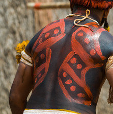 Kuikuro warrior wears a bead belt with many flags – indigenous people know more about us than we do about them!