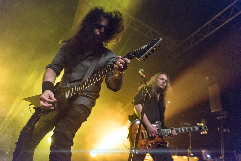 """Miland """"Mille"""" Petrozza (left), lead singer and guitarist, and Sami Yli-Sirniö (right), guitarist of the German thrash metal band Kreator, live in Lyon, France, January 2018.  © Philippe """"Pippo"""" Jawor All rights reserved."""