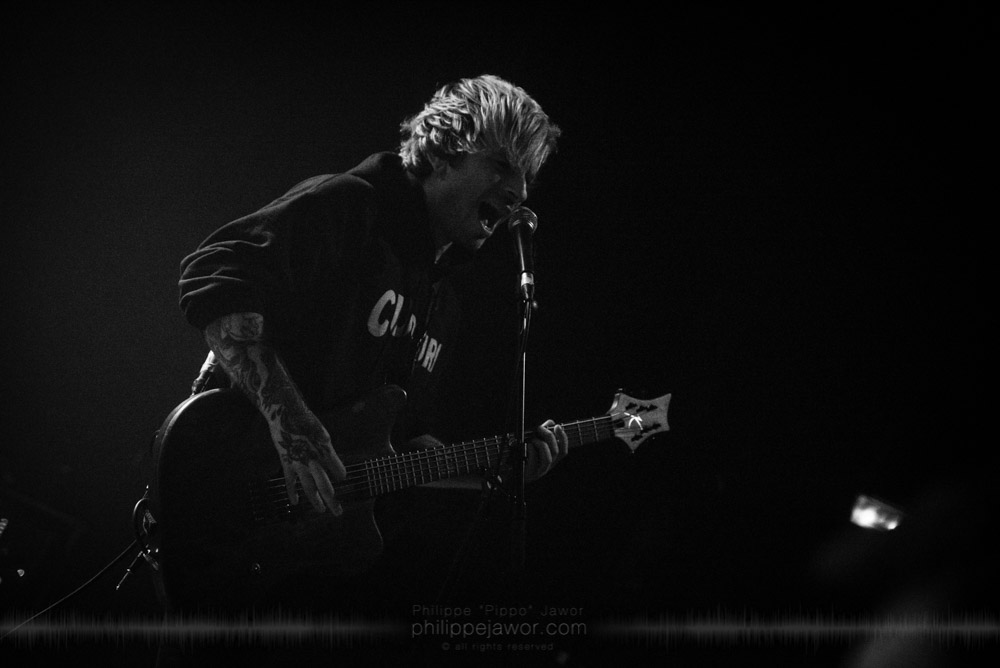 """Eugene Kamlyuk, guitarist of the American deathcore band Sworn In, live in Lyon, France, with the Impericon Never Say Die! Tour, November 2017.  © Philippe """"Pippo"""" Jawor All rights reserved."""