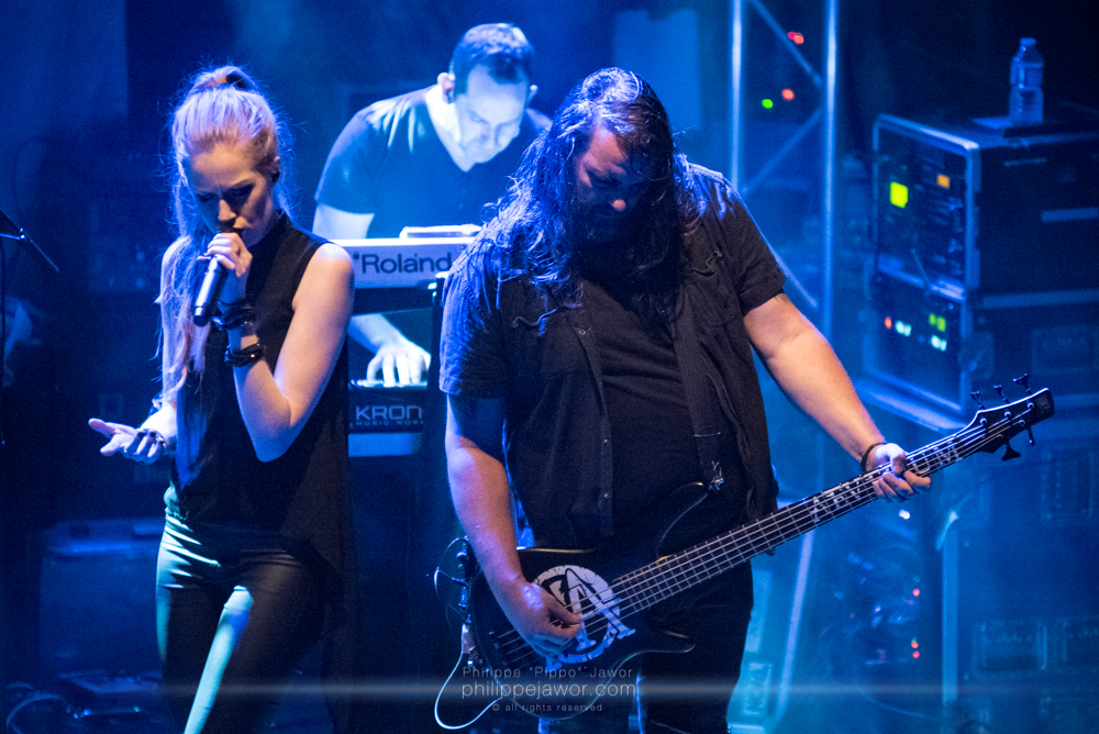 """Aeva Maurelle (left), singer,  Andreas Delvos (center) keyboards player, and Lars Dannenberg (right), bass player of the German alternative metal band Aeverium, live in Lyon, France, December 2017.  © Philippe """"Pippo"""" Jawor All rights reserved."""
