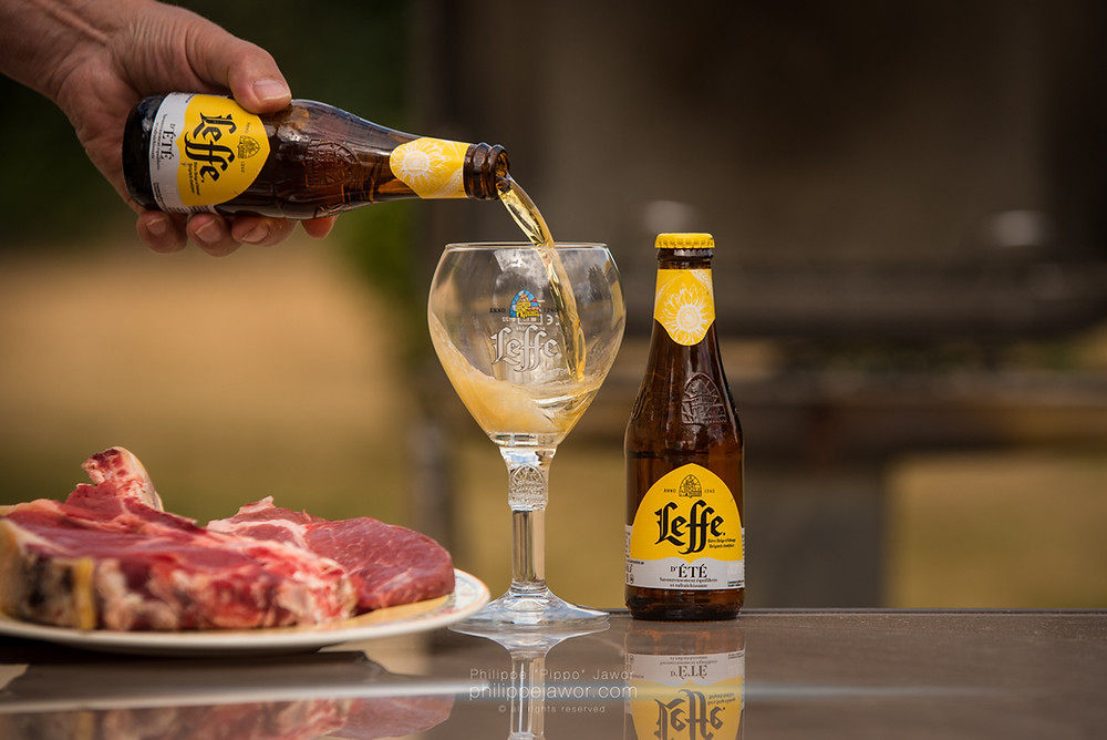 Beer pouring at a barbecue with a beef steak