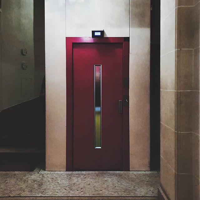 Red elevator door in Paris, France