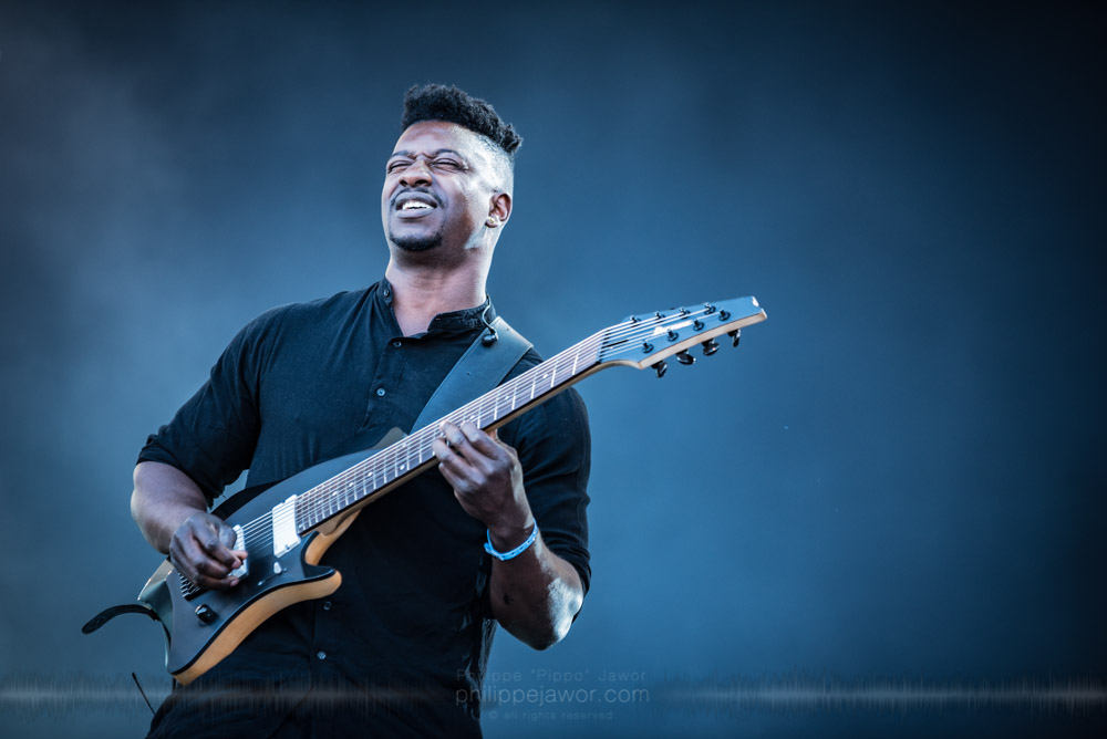 "Tosin Abasi, guitarist of the American instrumental progressive metal band Animals As Leaders, live at Hellfest Open Air festival, Clisson, France, June 2017.  On assignment for Metal Obs' Magazine.  © Philippe ""Pippo"" Jawor All rights reserved."