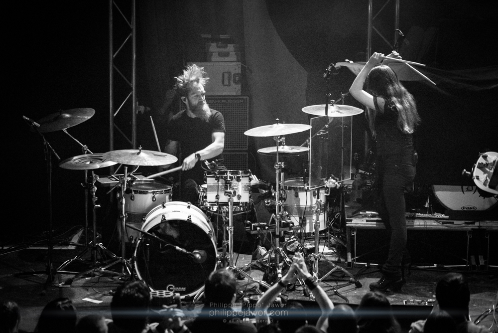 """Anna Murphy (right), lead singer, and Merlin Sutter (left), drummer of the Swiss folk metal band Cellar Darling, live in Lyon, France, December 2017.  © Philippe """"Pippo"""" Jawor All rights reserved."""