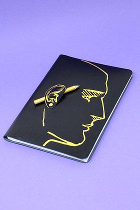 Quaderno in pelle con matita