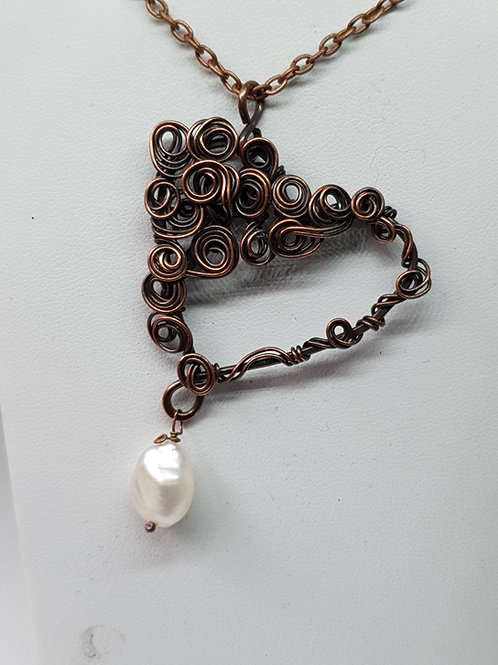 Statement  heart shaped patinated copper and freshwater pearl pendant necklace