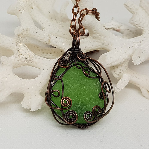 Copper wrapped kelly green sea glass pendant