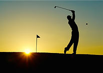 silhouette-of-man-playing-golf-during-su