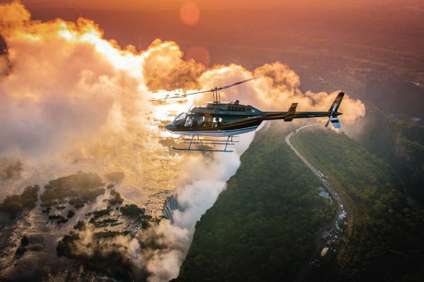 See Victoria Falls from a helicopter