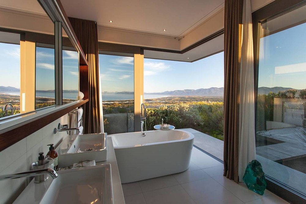 Bathroom with a view across walker Bay - Grootbos Nature Reserve