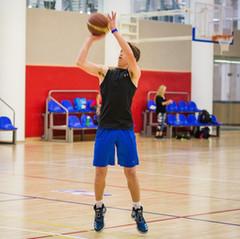 teen boy shooting basketball.jpg