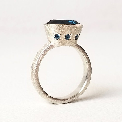 Silver ring with blue london topaz