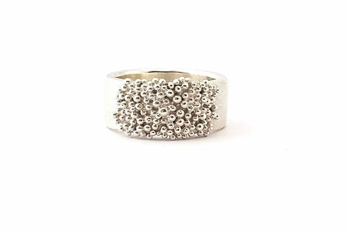 Large silver band with granulation.