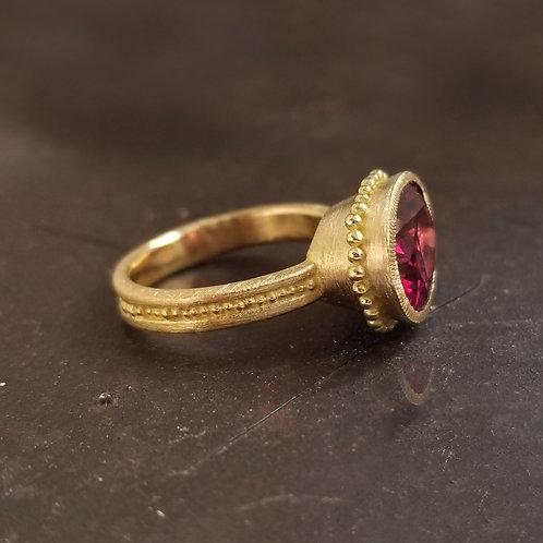 Large oval rhodolite garnet Roma ring