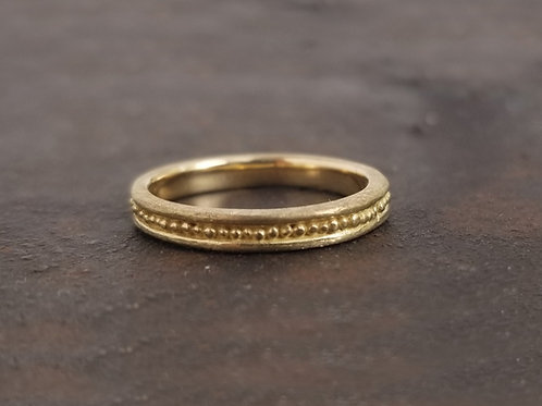 Ring with fine gold beads.