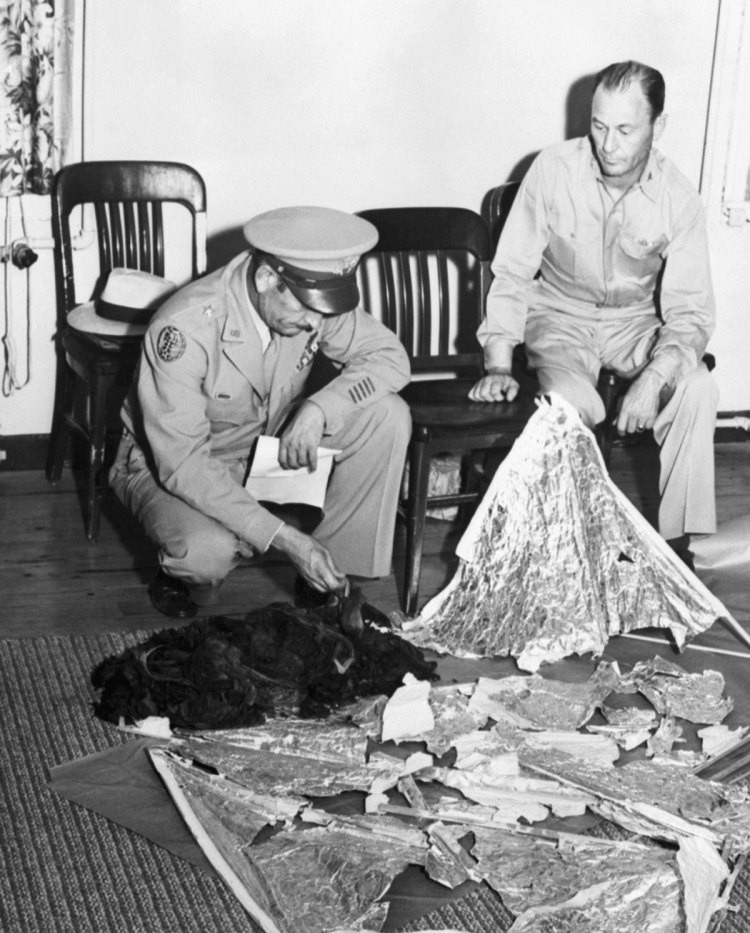 Member of the US Military displaying fragments from the Roswell incident
