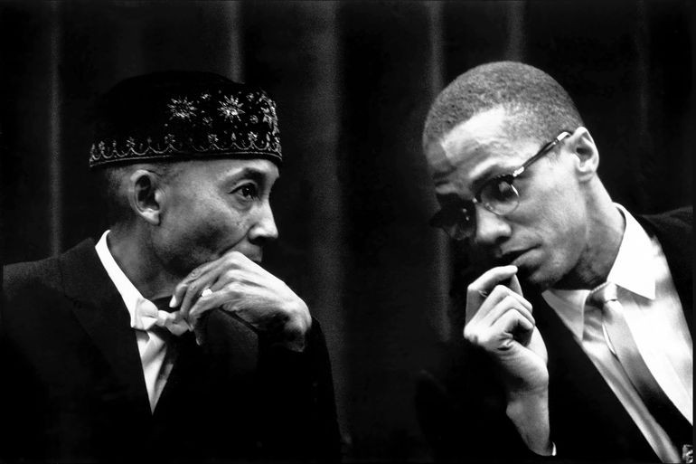 Malcolm X with Islamic leader Elijah Muhammad