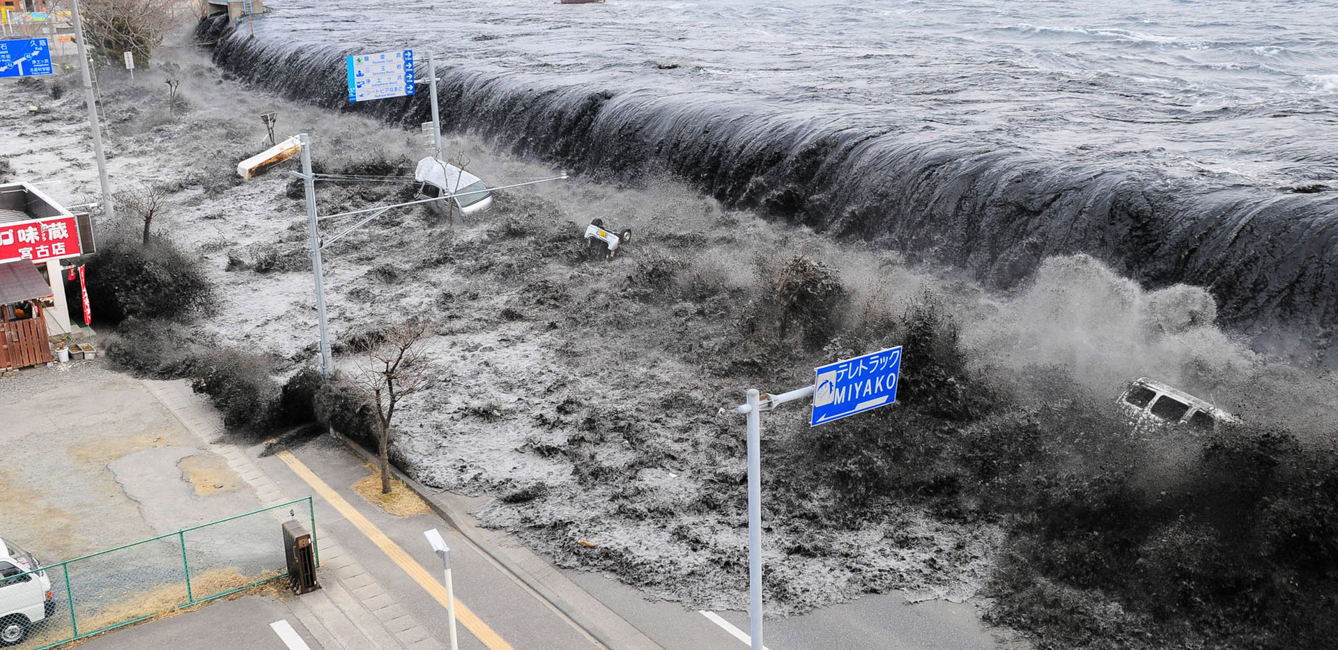 Tsunami crashing over seawalls and onto land
