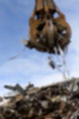 Grabber Loading A Metal Garbage.jpg