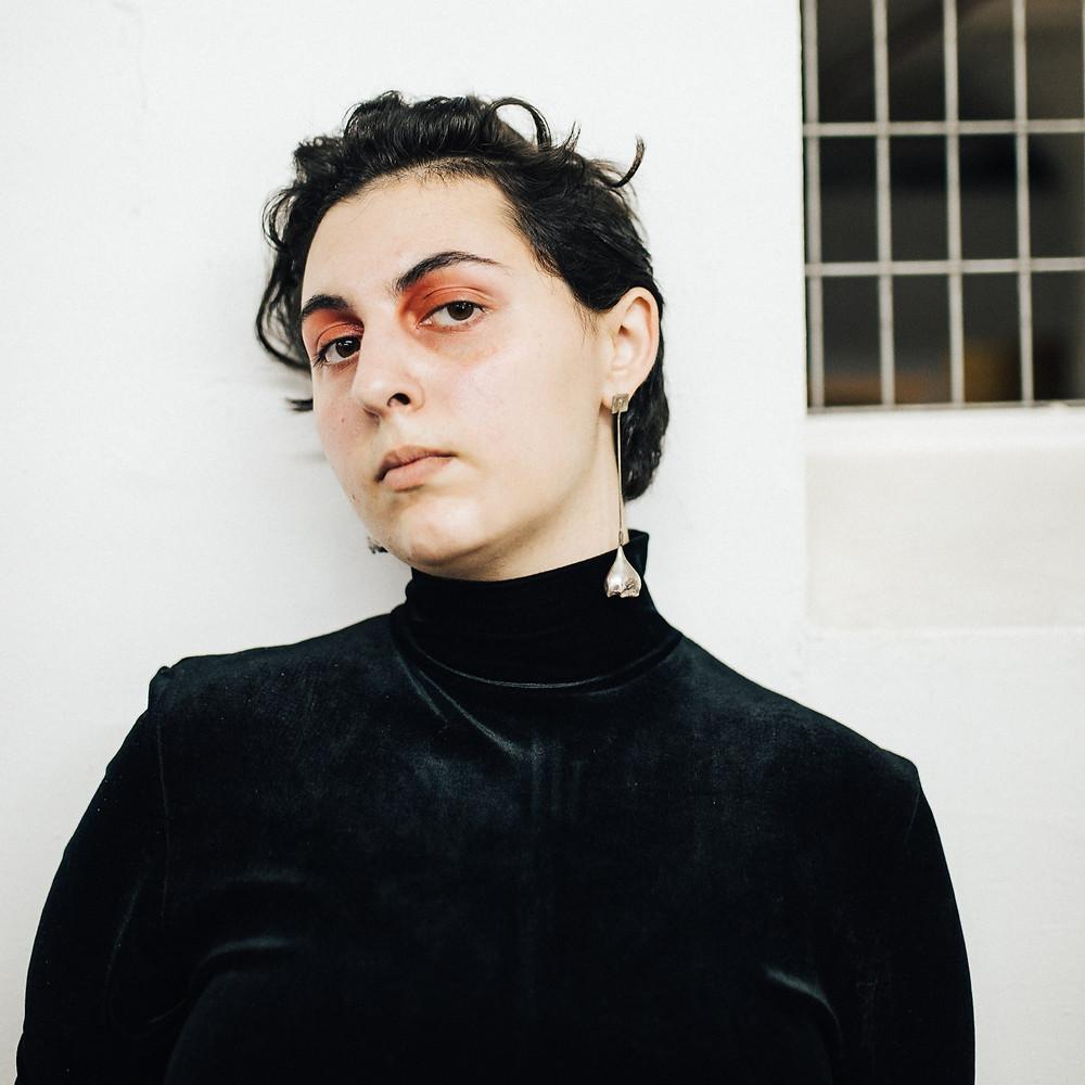 Myah wears Vintage top, Earrings by Felipe Tascon