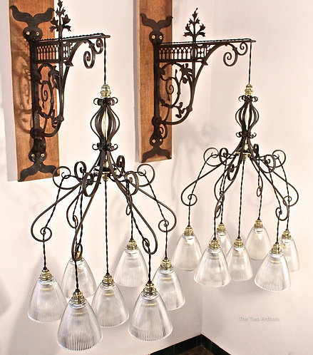 PAIR OF ARTS AND CRAFTS WROUGHT IRON & HOLOPHANE GLASS CHANDELIERS