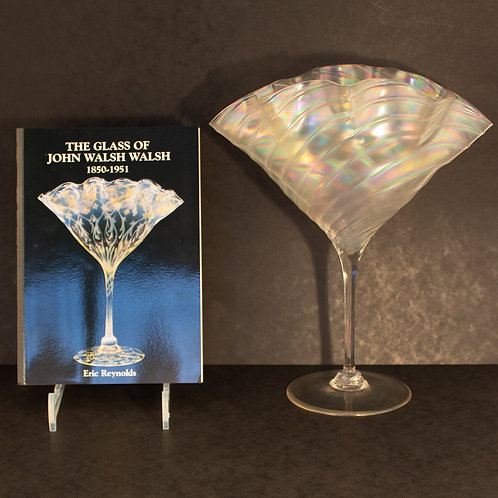 Superb Large Walsh Walsh Arts and Crafts Iridescent Pearlescent Glass Fan Vase next to reference book.
