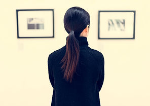 woman-looking-at-the-art-exhibition-P2GT