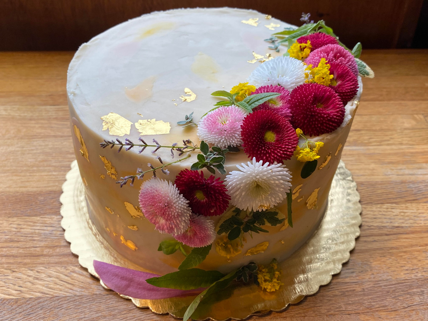 Cake with gold leaf and floral accent