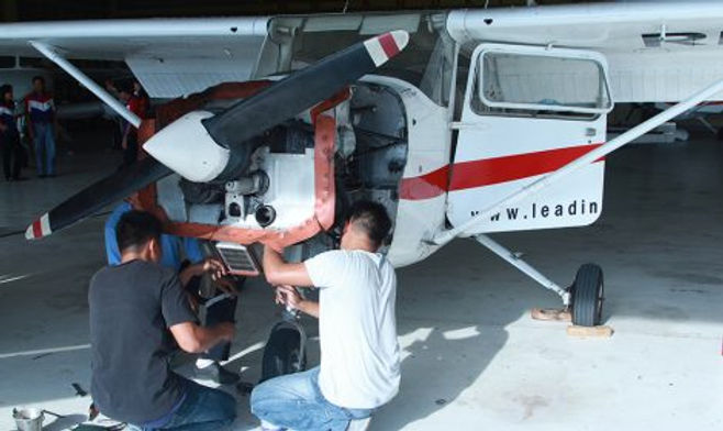 guy working on a cessna.jpg