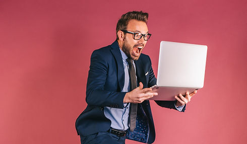businessman-with-computer-jumping_edited