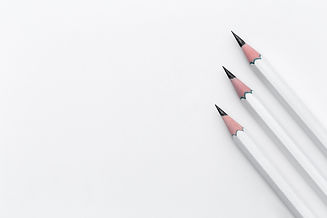 white-wooden-pencils-white-surface.jpg