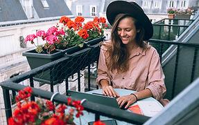 woman-wearing-beige-dress-shirt-using-la