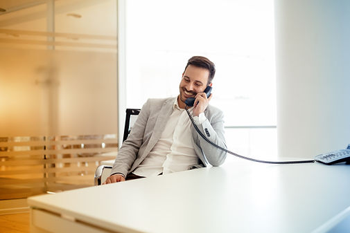 businessman-using-talking-on-phone-in-of