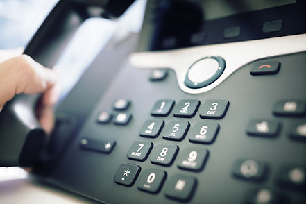 dialing-a-telephone-in-the-office-PWLAMG