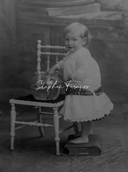 Young girl playing 1910