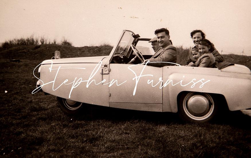 Family in a Mini Car 1950's