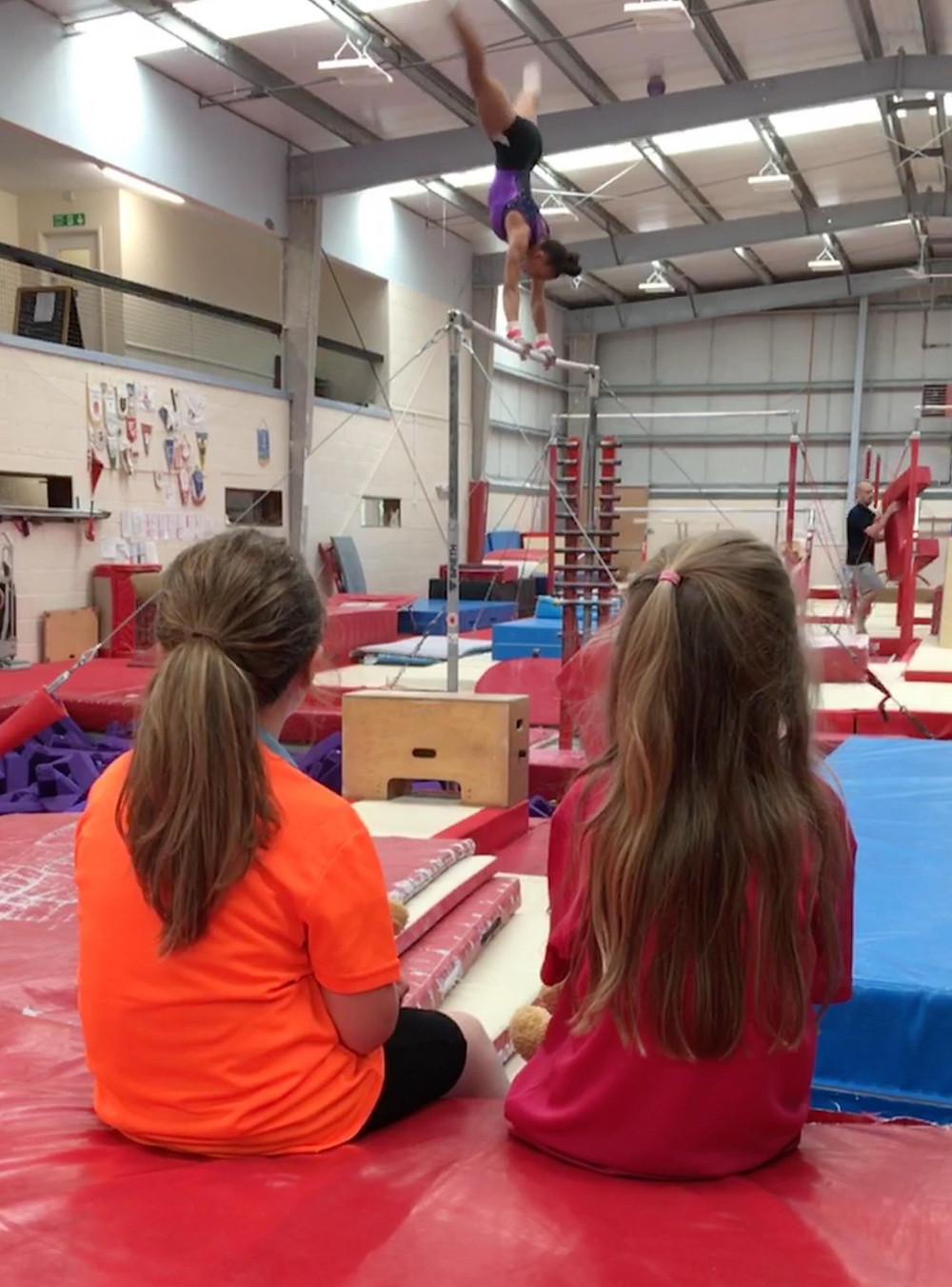 Maisie and Sienna watching the experts have a go!