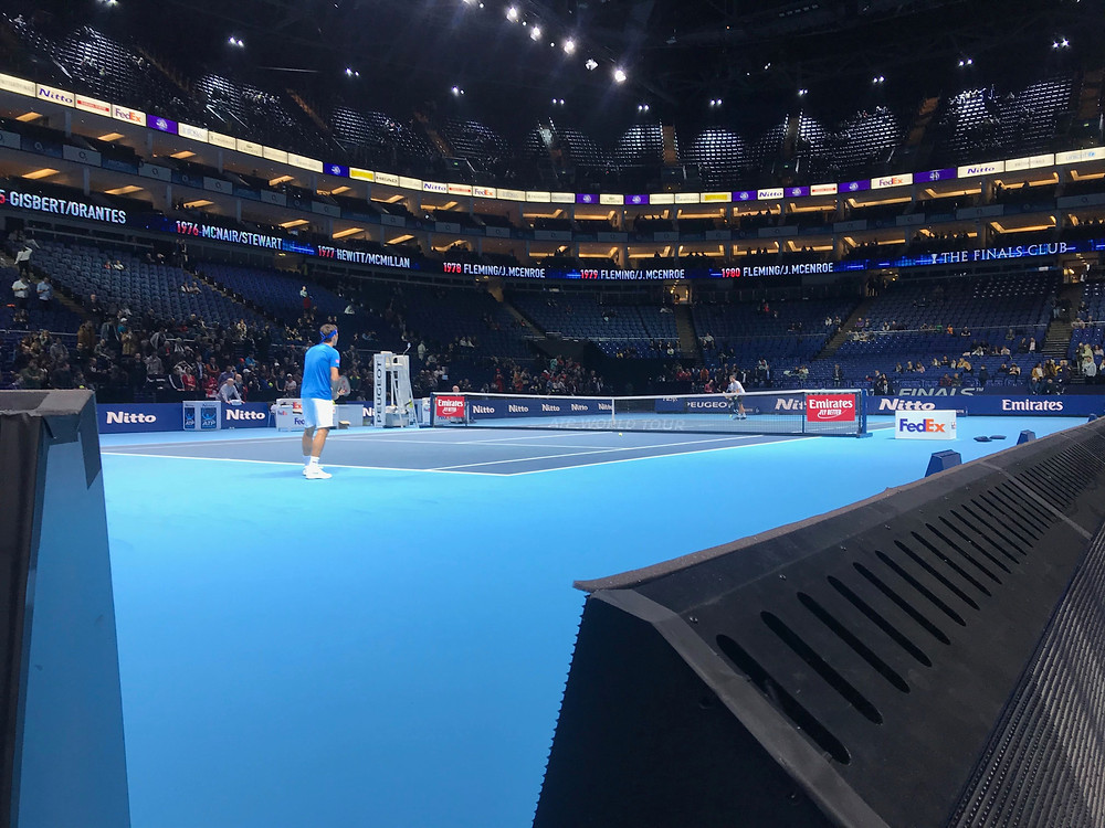 Given an AAA pass we were able to be 'court side' watching Roger Federer warm up, an unexpected part of this Sporting Wish
