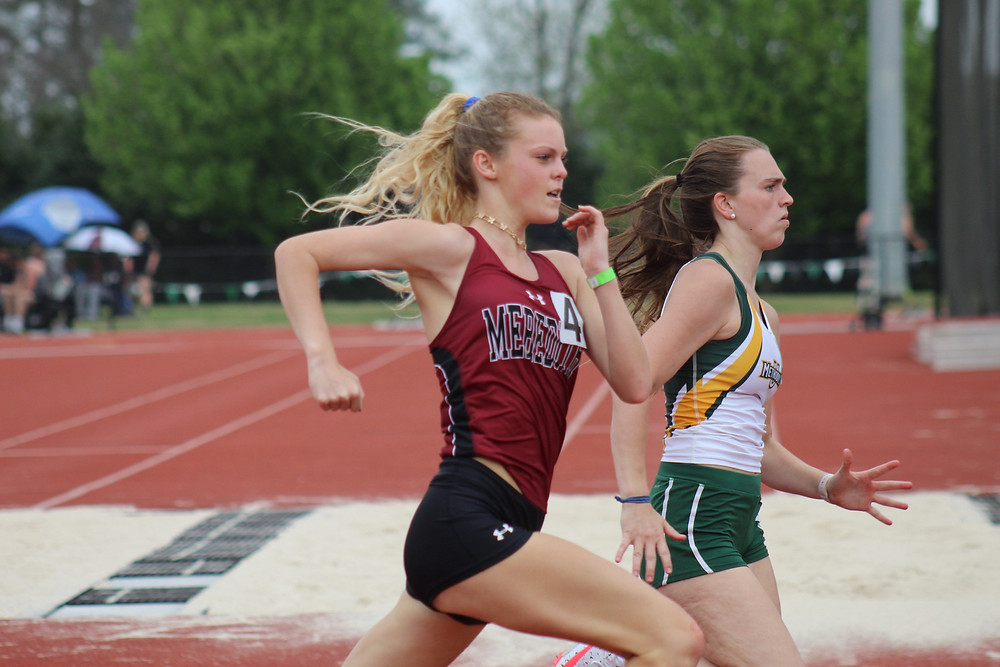 Two track and field runners, one from Meredith and one from Methodist