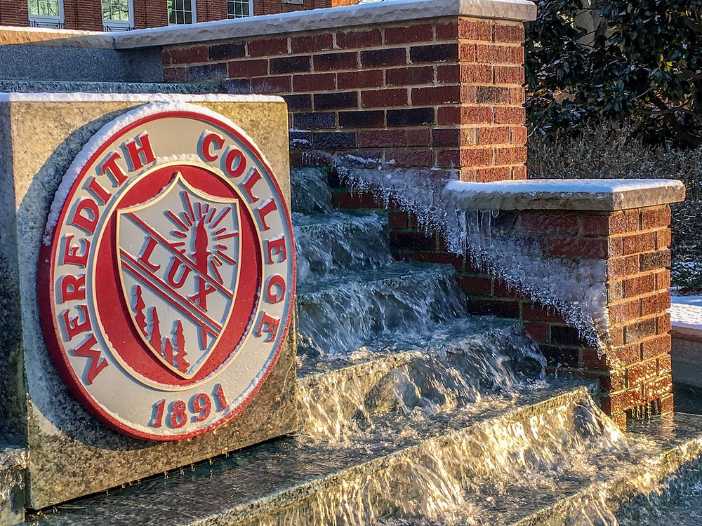 The Lux seal on the Meredith College fountain