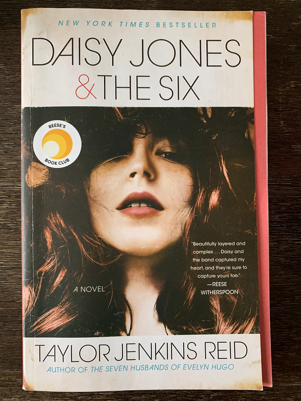 The book cover of Daisy Jones & The Six, with a brunette girl on the cover