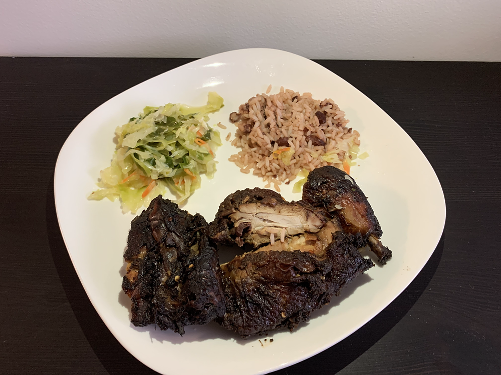 Jerk chicken, rice and beans, and steamed vegetables