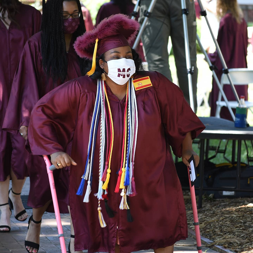 Tasia walking in her cap and gown
