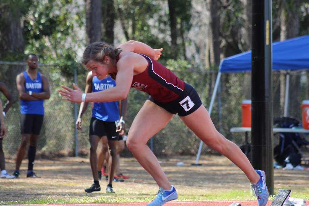 Ansley Buckname coming off the starting block for track