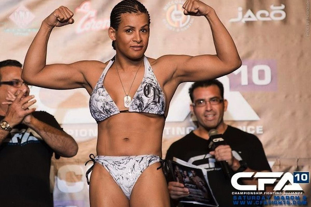 Fallon Fox posing for the camera and flexing her arms