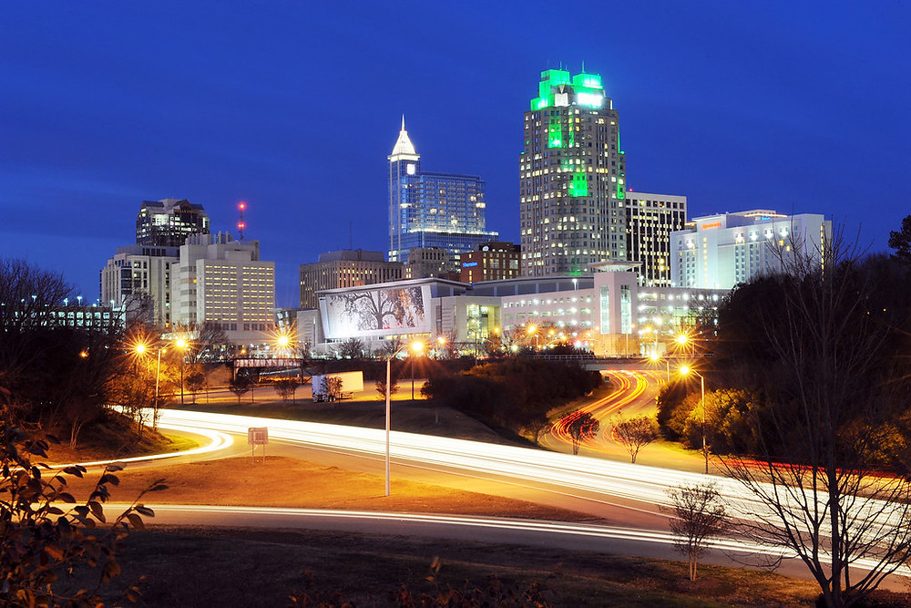 The Raleigh skyline at night