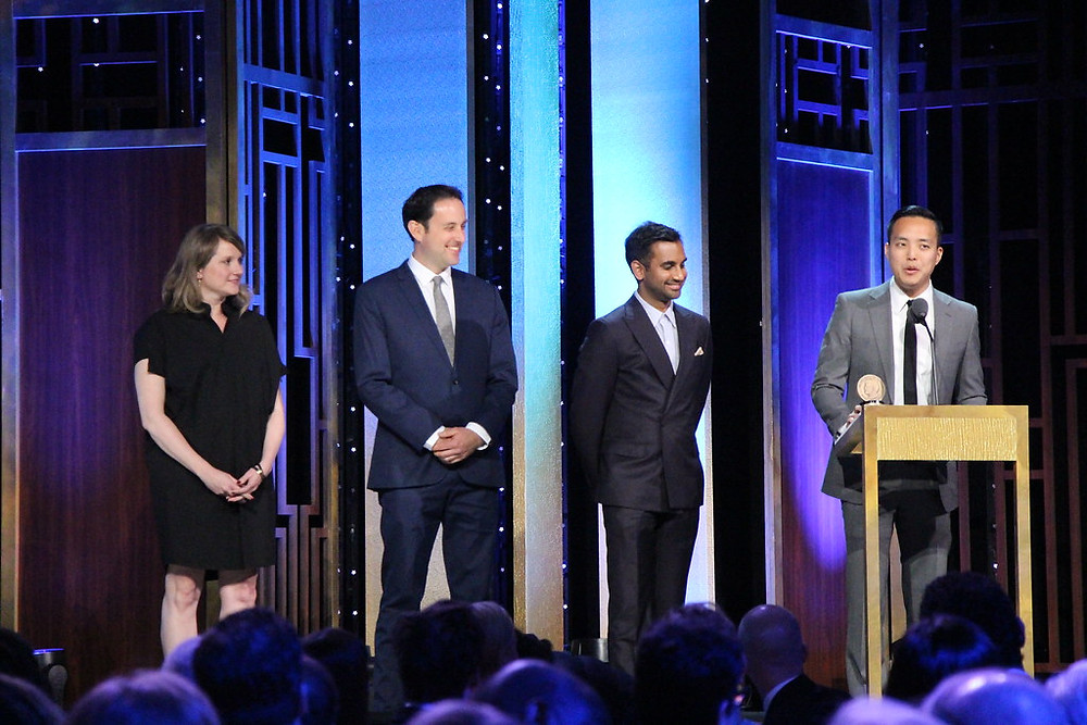 The creators of Master of None standing onstage at an awards show