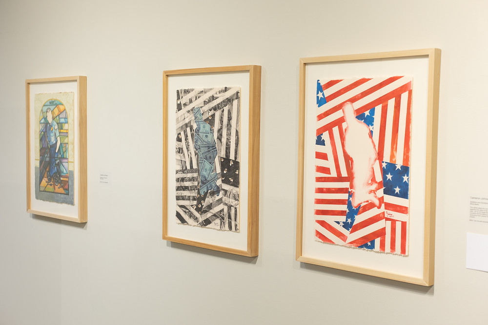 Three mixed media images, two of which feature the outline of the police officer who killed George Floyd kneeling on the ground (one in the midst of American Flags, one in the midst of black-and-white American flags and the officer filled in with dollars). The image on the far left shows the officer in the police uniform and is kneeling in front of a stained glass window.
