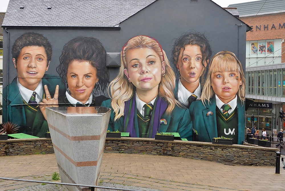 A mural of the cast of Derry Girls